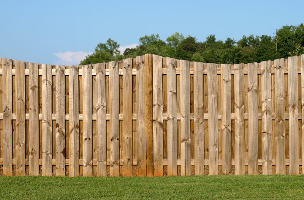 a scalloped wood fence landscape